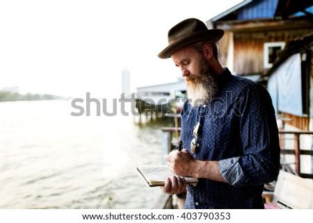 Man Journal Exploring Tourism Concept - stock photo