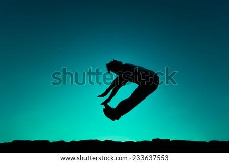 Man jump on blue background. Element of design. - stock photo