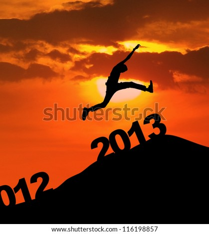 Man jump over 2013 number to embrace the new year - stock photo