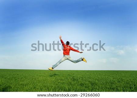 Man Jumping at meadow - stock photo
