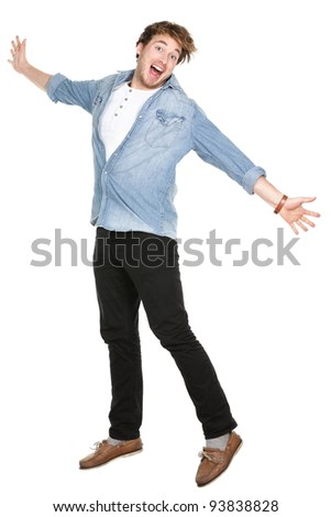 Man jumping excited in full body isolated on white background. Casual funny Caucasian guy in his twenties. - stock photo