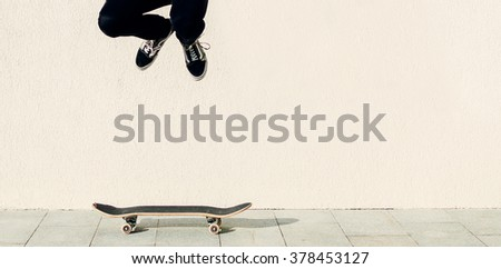 Man jumping on the skateboard on the city street - stock photo