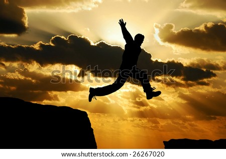 man jumping over a gap - stock photo