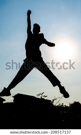 man jumping together,silhouette - stock photo