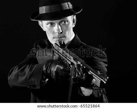 Man keeps a submachine gun - stock photo