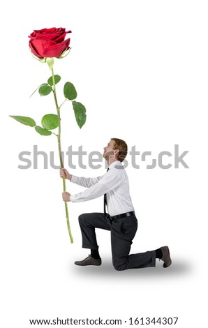 man kneeling a rose holding - stock photo