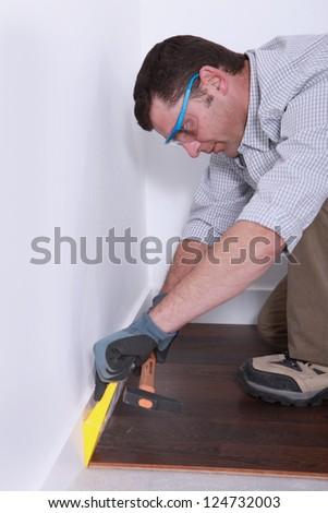 Man laying parquet floor - stock photo
