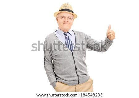 Man leaning against a wall and giving a thumb up isolated on white background - stock photo