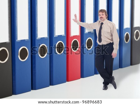 Man leaning against business archive folders - keeping data safe concept - stock photo