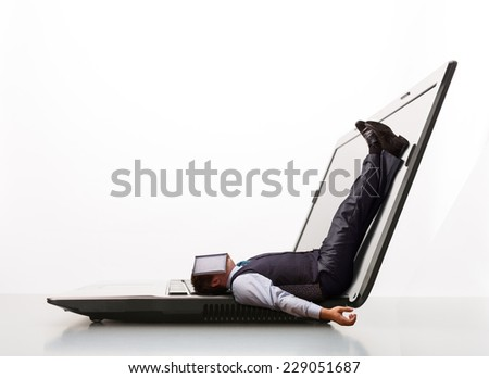 Man lies on laptop - stock photo