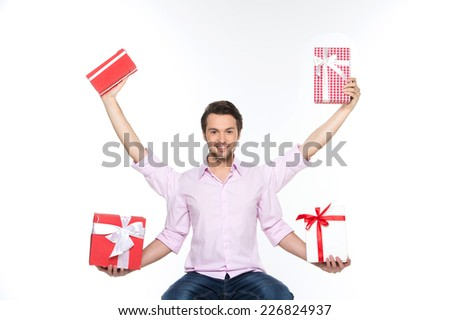 Man lifted presents up isolated on white background. waist up of guy sitting with four hands holding boxes - stock photo