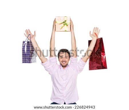 Man lifted presents up isolated on white background. waist up of guy with four hands holding bags - stock photo