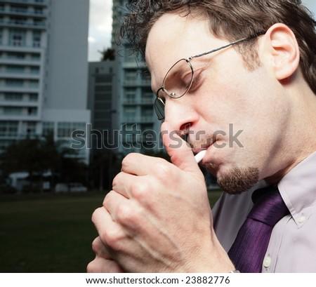 Man lighting a smoke - stock photo