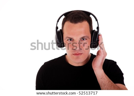man listening music in headphones, isolated on white background, studio shot - stock photo