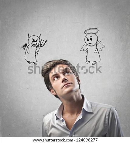 Man listening to an angel and a devil - stock photo