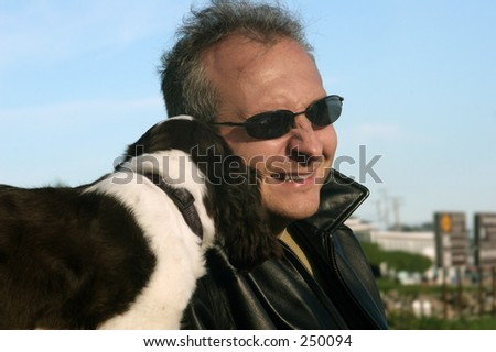 Man listening to his dog - stock photo