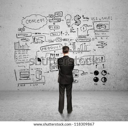 man looking at business plan - stock photo