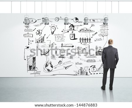 Man looking at business strategy - stock photo