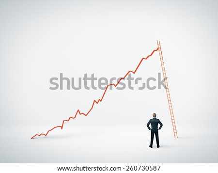 Man looking at diagram and ladder - stock photo