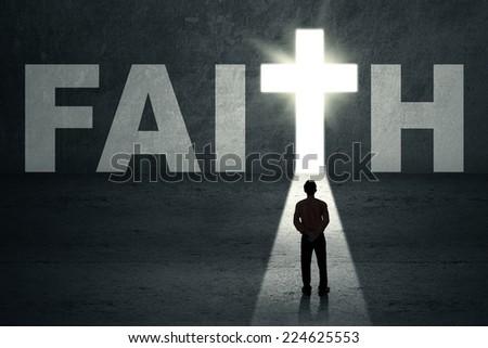 Man looking at faith door with bright light - stock photo