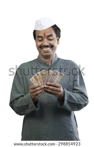Man looking at Indian currency - stock photo