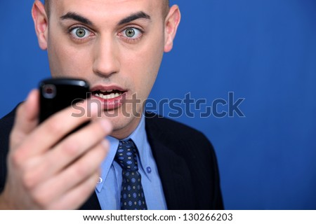 Man looking at mobile telephone - stock photo