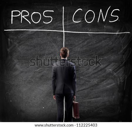 Man looking at the blackboard - stock photo