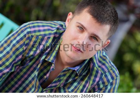 Man looking at the camera - stock photo
