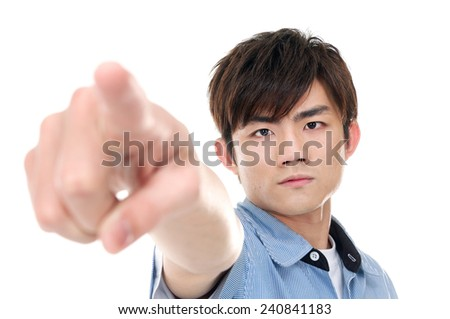 man looking at the camera and pointing her finger - stock photo
