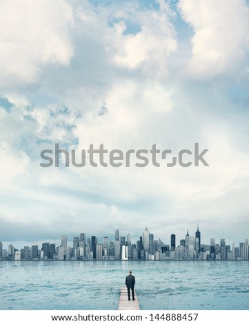 man looking at the city on a horizon - stock photo