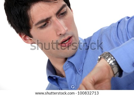 Man looking at the time - stock photo