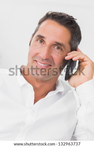 Man looking happy and talking on the mobile phone - stock photo