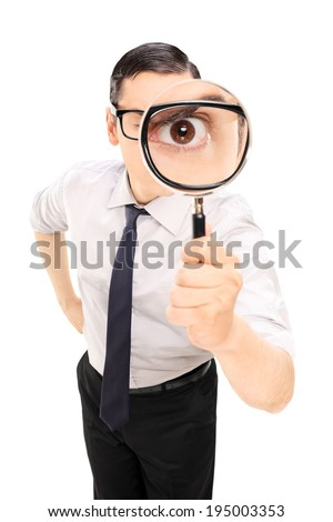 Man looking through a magnifying glass isolated on white background - stock photo