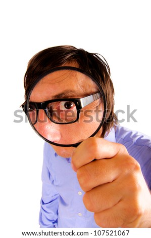 Man looking through magnifying glass - stock photo