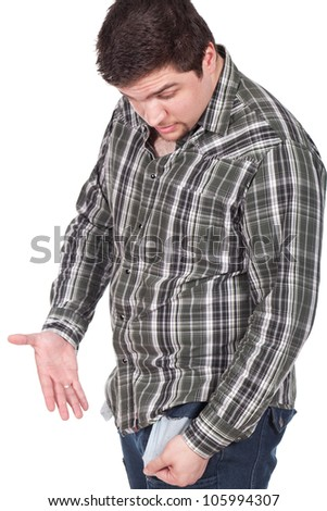 man looking to his empty pocket - stock photo