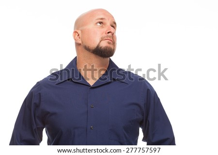 Man looking up and to the side.  Portrait of bald, handsome young man isolated on white background.  - stock photo