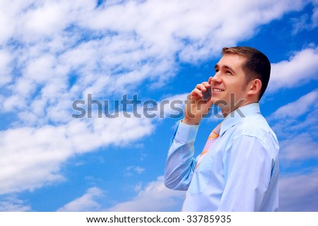 man looks on blue sky with sun and clouds - stock photo