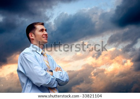 man looks on  sky with clouds - stock photo