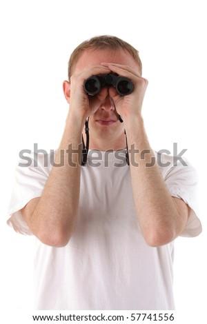 man looks through binoculars over white background - stock photo