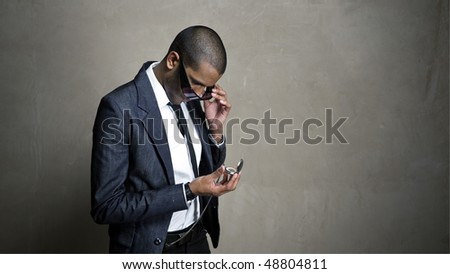 Man looks to his watch for a time update - stock photo