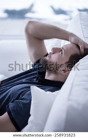 Man lying in bed with opened eyes - stock photo