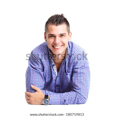 Man lying on floor with arms crossed  - stock photo