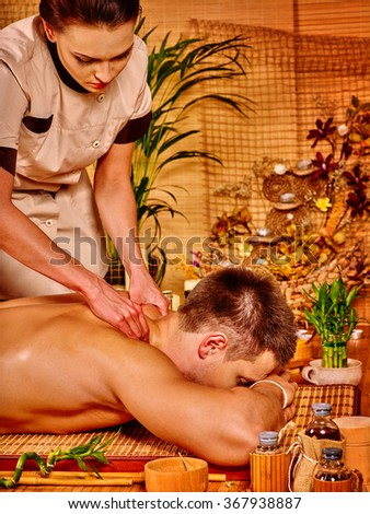 Man lying on his stomach and getting massage .  - stock photo