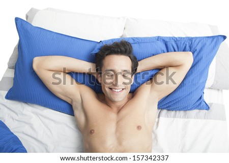 Man lying on the bed  - stock photo