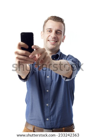 man make a photo with the phone - stock photo