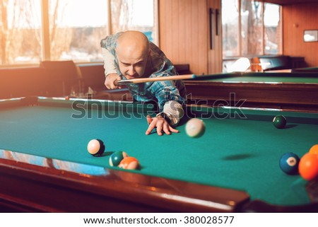 man makes a very powerful blow in the pool billiard game. American pool billiard. Pool billiard game. Billiard sport concept. - stock photo
