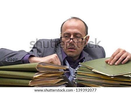 man making a burnout over a pile of folders - stock photo