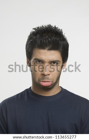 Man making a funny face - stock photo