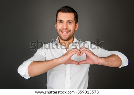 Man making a heart shape with his hands. - stock photo