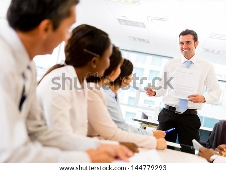 Man making a presentation in a successful business meeting - stock photo